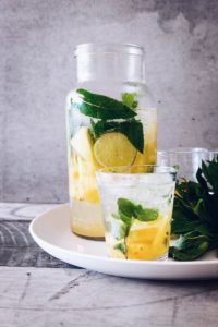 clear glass jar filled with lemonade juice